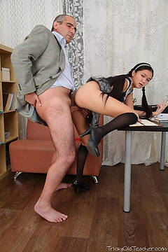 A smiling face is a sure sign that the teacher has got his way. He'll be fucking the ass off this Asian in no time at all