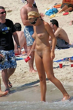 Spying on cute naked girls on the beach